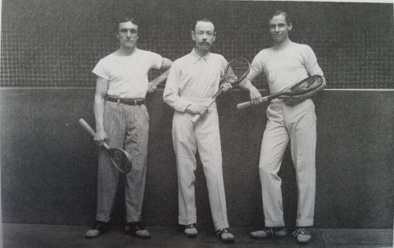 Old-fashioned group photo of men holding tennis rackets at GCU.