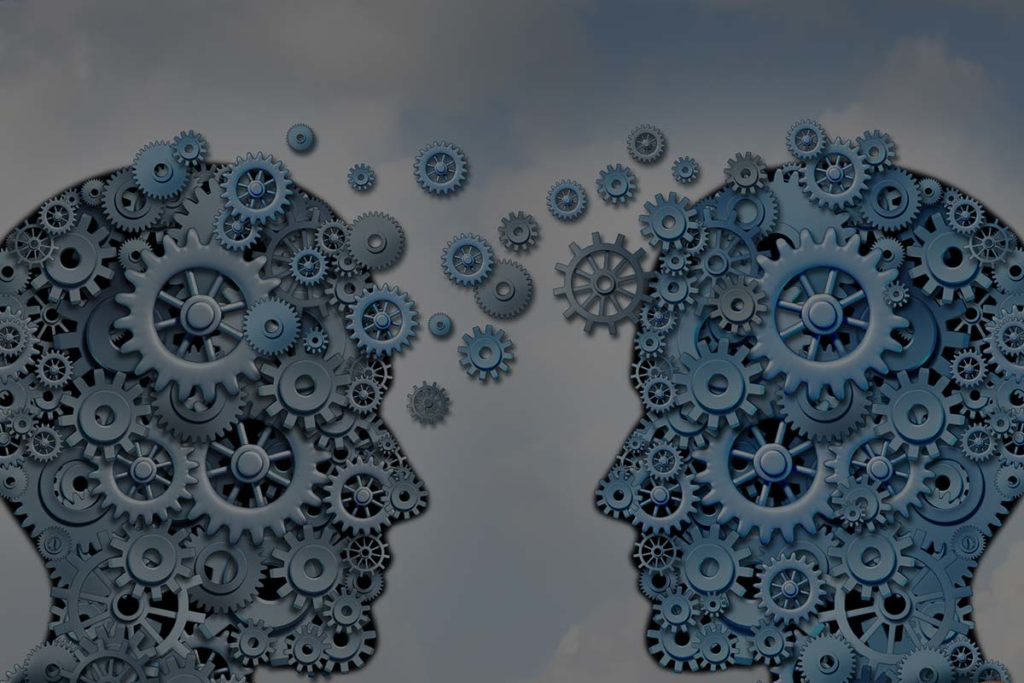 two groups of gears forming two heads