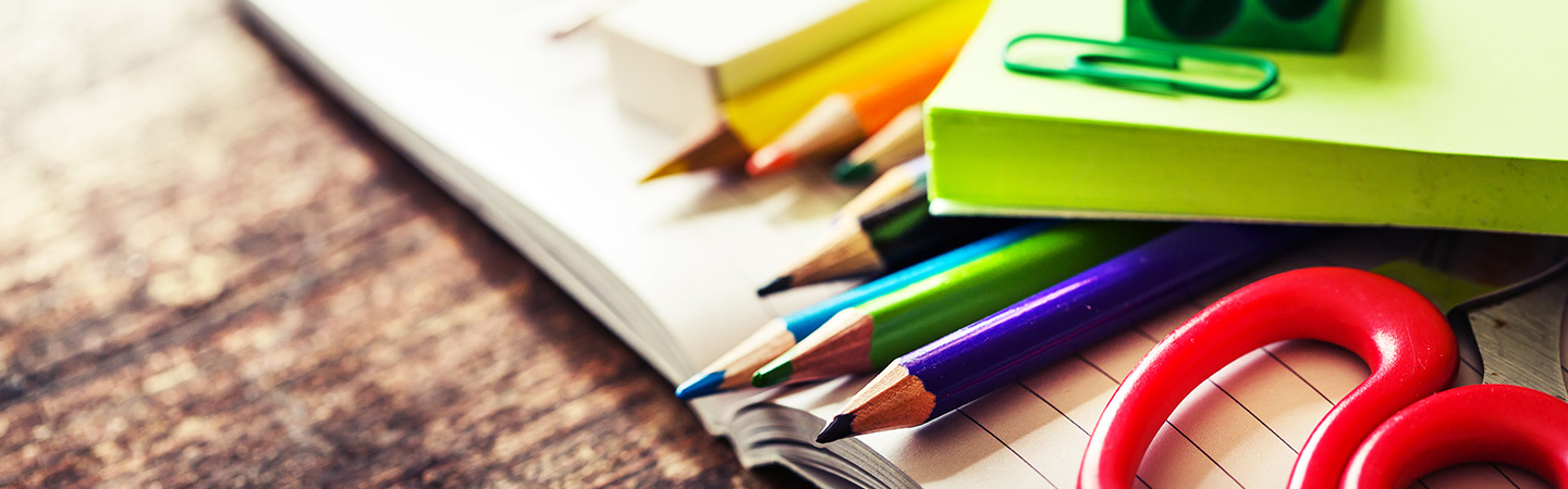 photo of assorted pencils, eraser, scissors, and post-it notes